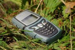 Teléfono móvil perdido Imágenes de archivo libres de regalías