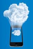 Teléfono móvil que conecta con la nube Imagen de archivo libre de regalías