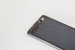 Teléfono móvil quebrado Imagen de archivo libre de regalías