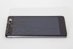 Teléfono móvil quebrado Fotografía de archivo libre de regalías