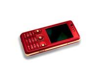 Teléfono móvil rojo Imagenes de archivo