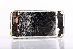 Teléfono móvil roto Fotografía de archivo libre de regalías