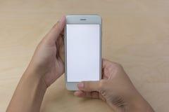 Teléfono móvil usando concepto con la pantalla en blanco Fotos de archivo