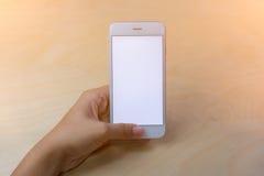 Teléfono móvil usando concepto con la pantalla en blanco Imagenes de archivo