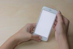 Teléfono móvil usando concepto con la pantalla en blanco Foto de archivo