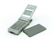 Teléfono móvil viejo con su batería Imagen de archivo libre de regalías