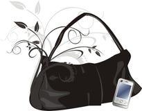 Teléfono móvil y bolso mujeril Imagen de archivo