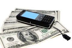Teléfono móvil y dólares Imagen de archivo libre de regalías