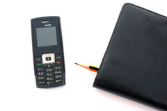 Teléfono móvil y diario Fotografía de archivo libre de regalías