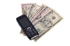 Teléfono móvil y dinero Imagen de archivo libre de regalías