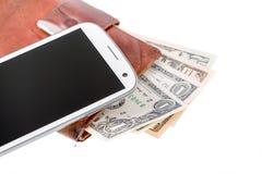 Teléfono móvil y dinero en blanco Foto de archivo