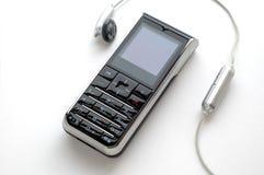 Teléfono móvil y el auricular Foto de archivo libre de regalías