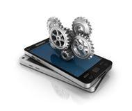 Teléfono móvil y engranajes. Concepto del desarrollo de aplicaciones. libre illustration