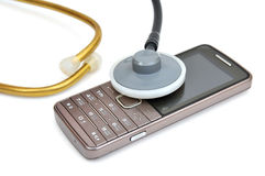 Teléfono móvil y estetoscopio Fotografía de archivo libre de regalías