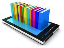 Teléfono móvil y libro Fotografía de archivo libre de regalías