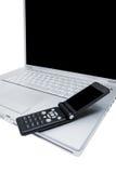 Teléfono móvil y ordenador Imagen de archivo