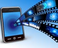 Teléfono móvil y películas Fotografía de archivo