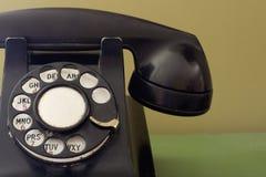 Teléfono negro andrajoso de la vendimia Imágenes de archivo libres de regalías