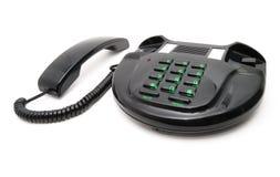 Teléfono negro con números verdes Foto de archivo libre de regalías