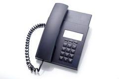 Teléfono negro de la oficina aislado Imagen de archivo