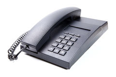 Teléfono negro de la oficina aislado Foto de archivo