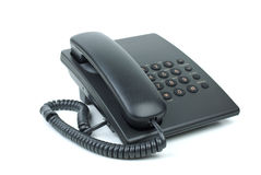 Teléfono negro de la oficina con el microteléfono on-hook imágenes de archivo libres de regalías