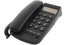 Teléfono negro del escritorio foto de archivo