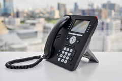 Teléfono negro del IP - teléfono de la oficina Foto de archivo libre de regalías