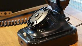 Teléfono negro del vintage - diales del hombre