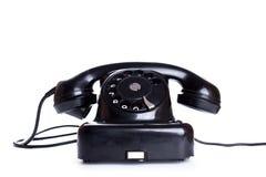 Teléfono negro, viejo o clásico, aislado en un fondo blanco Fotos de archivo libres de regalías