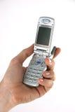 Teléfono portátil a disposición Foto de archivo libre de regalías