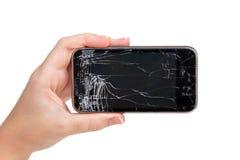 Teléfono quebrado en una mano Fotos de archivo libres de regalías