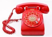 Teléfono rojo de la casa del estilo retro del dial de la obra clásica 1970 - el an o 80 Imagenes de archivo