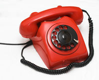 Teléfono rojo usado viejo Imagenes de archivo