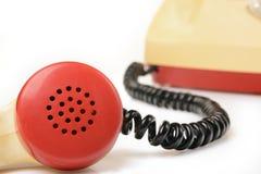Teléfono rotatorio viejo en blanco Fotos de archivo libres de regalías