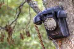 Teléfono roto viejo fotos de archivo