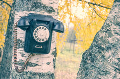 Teléfono roto viejo imágenes de archivo libres de regalías