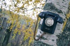 Teléfono roto viejo imagen de archivo libre de regalías