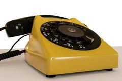 Teléfono viejo aislado en el fondo blanco Fotografía de archivo