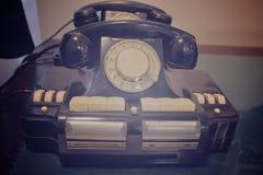 Teléfono viejo del color del negro de la tecnología Fotos de archivo libres de regalías