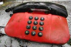 Teléfono viejo del rojo de los años 80 Foto de archivo libre de regalías