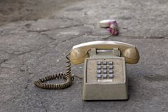 Teléfono viejo sucio Foto de archivo libre de regalías