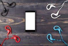 Teléfono y auriculares para el deporte Foto de archivo libre de regalías