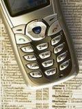 Teléfono y libro Imagen de archivo libre de regalías