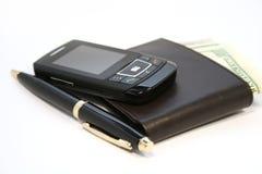 Teléfono y monedero Fotos de archivo libres de regalías