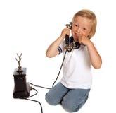 Teléfono y muchacho antiguos Imagenes de archivo