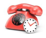 Teléfono y reloj Fotos de archivo libres de regalías