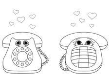 Teléfonos de escritorio enamorados, contornos Imagenes de archivo