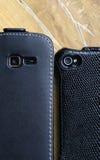 Teléfonos elegantes que le miran Foto de archivo libre de regalías