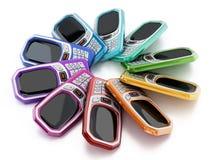 Teléfonos móviles coloreados multi del viejo estilo con el telclado numérico ilustración 3D Imagenes de archivo